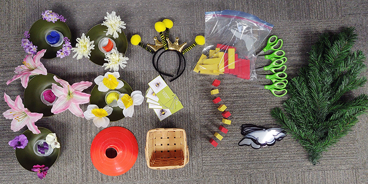 scissors, flowers, bee hats and more pollinator bin contents